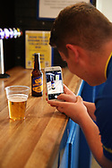 AFC Wimbledon fan enjoying the new Wimbledon beer during the Pre-Season Friendly match between AFC Wimbledon and Burton Albion at the Cherry Red Records Stadium, Kingston, England on 21 July 2017. Photo by Matthew Redman.