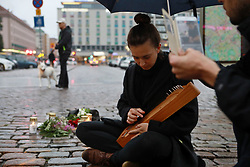 (170818) -- TURKU (FINLAND), Aug. 18, 2017 (Xinhua) -- A woman mourns victims of the stabbing attacks in Turku, southwestern Finland, on Aug. 18, 2017. Several people were stabbed in downtown Turku, southwestern Finland on Friday, when more than one man mounted the attacks simultaneously. At least two died and eight others were injured, according to local media. (Xinhua/Zhang Xuan)  (Photo by Xinhua/Sipa USA)