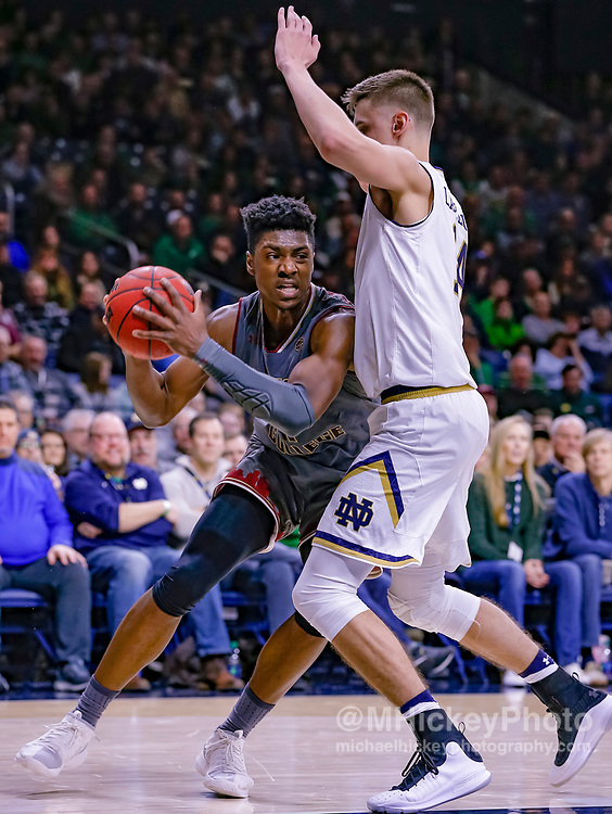 SOUTH BEND, IN - JANUARY 12: Jairus Hamilton #1 of the Boston College Eagles drives to the basket against Nate Laszewski #14 of the Notre Dame Fighting Irish at Purcell Pavilion on January 12, 2019 in South Bend, Indiana. (Photo by Michael Hickey/Getty Images) *** Local Caption *** Jairus Hamilton; Nate Laszewski