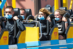 © Licensed to London News Pictures. 18/07/2020. Brighton, UK. Members of the public wear protective masks when taking a ride on the attractions on the Brighton Palace Pier to protect themselves and others again the spread of the Coronavirus. Photo credit: Hugo Michiels/LNP