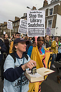 Campaigners against the closure by Lambeth council  of Carnegie Library in Herne Hill, south London, march through Brixton, some after emerging from the premises on the 10th day of occupation, 9th April 2016. The local community have been occupying their important resource for learning and social hub and after a long campaign, Lambeth have gone ahead and closed the librarys doors for the last time because they say, cuts to their budget mean millions must be saved. They plan to re-purpose it into a gym although details are unknown.