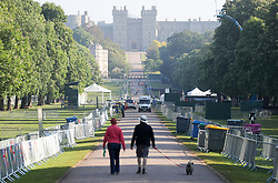 Dog walkers make their way down the Long Walk in Windsor, as the clean-up continues after the royal wedding.