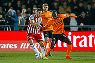 Barnet defender David Tutonda (23) holds off Brentford forward Neal Maupay (9) during the The FA Cup fourth round match between Barnet and Brentford at The Hive Stadium, London, England on 28 January 2019.