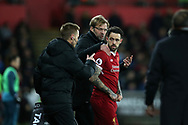 Liverpool manager Jurgen Klopp has a chat with Danny Ings of Liverpool as he sends him on as a replacement in the 2nd half. Premier league match, Swansea city v Liverpool at the Liberty Stadium in Swansea, South Wales on Monday 22nd January 2018. <br /> pic by  Andrew Orchard, Andrew Orchard sports photography.