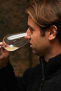 Philippe Viret tasting a barrel sample of fermenting white wine.  Domaine Viret, Saint Maurice sur Eygues, Drôme Drome France, Europe