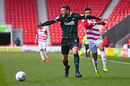 Ryan Edwards of Plymouth Argyle (5) and Tyler Smith of Doncaster Rovers (18) in action during the EFL Sky Bet League 1 match between Doncaster Rovers and Plymouth Argyle at the Keepmoat Stadium, Doncaster, England on 13 April 2019.
