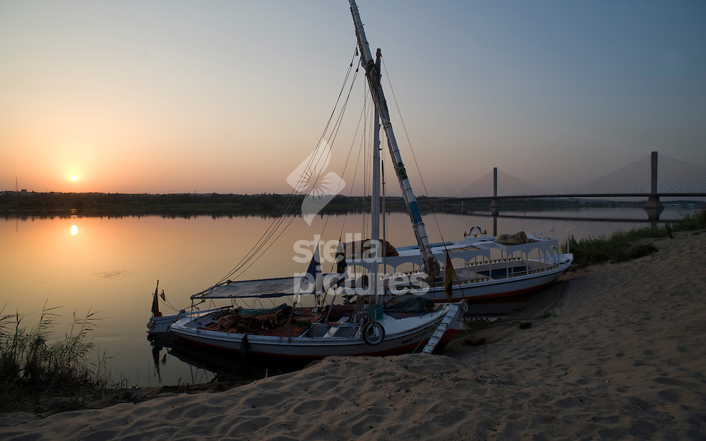 Picture by Daniel Hambury. .29/8/10..The sun rises over the Nile and a felucca on the Nile near to Aswan, Egypt.