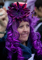 © Licensed to London News Pictures. 08/03/2017. London, UK. Woman dressed in a purple wig campaigns with the group WASPI (Women Against State Pension Inequality), outside The House of Parliament in London, on the day that  British chancellor Philip Hammond delivers his 2017 Budget to Parliament. Photo credit: Ben Cawthra/LNP