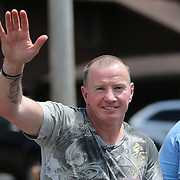 CANASTOTA, NY - JUNE 14: Boxer Micky Ward waves to fans during the parade at the International Boxing Hall of Fame induction Weekend of Champions events on June 14, 2015 in Canastota, New York. (Photo by Alex Menendez/Getty Images) *** Local Caption *** Micky Ward