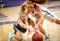 Brooke Hollawell (left) of Manasquan and Maddie Fagan (14) of RFH vie for a loose ball. Rumson girls were defeated by Manasquan on their home court in the  Central Group II girls basketball final on Monday, March 9, 2020./ Russ DeSantis for the Asbury Park Press
