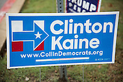 A campaign sign for Hillary Clinton outside a polling location in Plano, Texas on November 8, 2016. (Cooper Neill for The Texas Tribune)