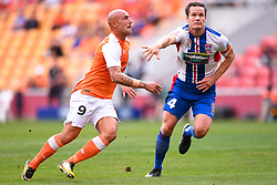 October 22, 2017 - Brisbane, QUEENSLAND, AUSTRALIA - Massimo Maccarone of the Roar (#9, left) and Nigel Boogaard of the Jets (#4) compete for the ball during the round three Hyundai A-League match between the Brisbane Roar and the Newcastle Jets at Suncorp Stadium on October 22, 2017 in Brisbane, Australia. (Credit Image: © Albert Perez via ZUMA Wire)