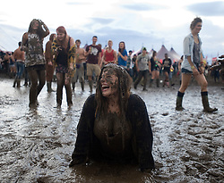 © Licensed to London News Pictures. 26/08/2011. Reading, UK. Katherine Vincent (18) enjoying the mud on day one of Reading Festival 2011 in Reading, Berkshire today (26/08/2011). Photo credit: Ben Cawthra/LNP