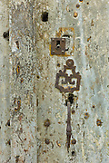 Traditional French lock in a doorway in quaint town of Castelmoron d'Albret in Bordeaux region, Gironde, France