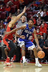 21 February 2018:  De'Antae McMurray hooks his way past Elijah Clarance during a College mens basketball game between the Drake Bulldogs and Illinois State Redbirds in Redbird Arena, Normal IL