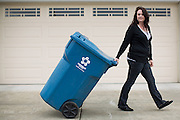 Republic Services of Santa Clara County employees collect trash, greens, and recycling during a marketing campaign for Republic Services of Santa Clara County in Milpitas, California, on February 26, 2014. (Stan Olszewski/SOSKIphoto)