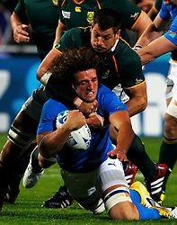 South Africa Springboks' Pierre Spies (top) tackles Namibia captain Jacques Burger during their Rugby World Cup Pool D match at North Harbour Stadium in Auckland September 22, 2011. REUTERS/Mike Hutchings (NEW ZEALAND  - Tags: SPORT RUGBY)