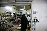 Omani woman shoping<br /> <br /> The Sultanate of Oman is a country in Southwest Asia. It borders the United Arab Emirates in the northwest, Saudi Arabia in the west, and Yemen in the southwest.<br /> The oil discovery, in the 60's, started to transform this asleep country. Today, Oman is  torn by modern roads, industrialized and rich ( Omanization ). The tradition still dominates life of the 2,5 million inhabitants: strong religion ( muslim ), traces of tribal loyalties and a very characteristic culture.