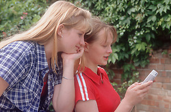 Two teenage girls playing computer game,