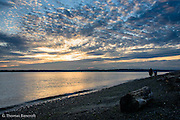 A beautiful summer evening ends perfectly with a spectacular sunset across Elliot Bay and a walk along the beach.  The feeling of contentment oozes from the evening and one is left feeling how great life is.