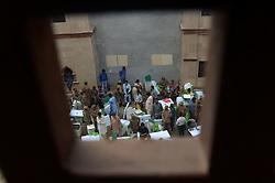 July 26, 2018 - Lahore, Punjab, Pakistan - Polling officers with army soldiers carry the election material escorts them as they come out from a voting material distribution. The election Commission announced that the country's security forces will be deployed to polling stations to ensure free, fair and transparent national elections on July 25. (Credit Image: © Rana Sajid Hussain/Pacific Press via ZUMA Wire)
