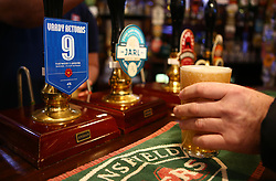 A fan with a pint of 'Vardy Returns' at the Strawberry Gardens Pub before the FA Cup, third round match at Highbury Stadium, Fleetwood