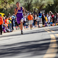 100414       Cable Hoover<br /> <br /> Miyamura Patriot Niles Thomas charges down the final leg of boys varsity race to finish first in the Gallup Invitational cross country meet at Red Rock Park Saturday.