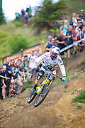 Gee Atherton, of Great Britain, descends into the final stages of the DH course during the Crankworx Rotorua Downhill presented by iXS inaugural Crankworx Rotorua event held at Skyline Rotorua, Rotorua, New Zealand, March 25-29, 2015.