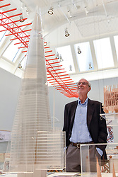 """© Licensed to London News Pictures. 12/09/2018. LONDON, UK. Internationally renowned architect and Honorary Royal Academician Renzo Piano at a preview of """"Renzo Piano: The Art of Making Buildings"""", an exhibition comprising 16 of his most significant projects.  He is seen next to a model of The Shard in London.   The exhibition runs 15 September to 20 January 2019 at the Royal Academy of Arts in Piccadilly.  Photo credit: Stephen Chung/LNP"""