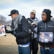 High school students selling Obama-themed calendars at the National Mall on the eve of Barack Obama's inauguration on 01/20/2009 which was also MLK Jr. day. The coincidence of a national holiday honouring Martin Luther King occurring within a day of Mr Obama's inauguration added to the deep symbolism of the day's events.