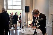 FRIEDHELM HUETTE, Sydney cocktails. Brandon rooms. ICA. London. 11 October 2011. <br /> <br />  , -DO NOT ARCHIVE-© Copyright Photograph by Dafydd Jones. 248 Clapham Rd. London SW9 0PZ. Tel 0207 820 0771. www.dafjones.com.