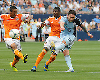 Football - Major League Soccer - Houston Dynamo at Sporting KC - The Sporting KC and the Houston Dynamo played to a 1-1 tie in regulation time at Sporting KC Park in Kansas City, Kansas, USA. Sporting KC forward Claudio Bieler (16, right) clears the ball past Houston Dynamo midfielder Ricardo Clark (13, left) and Houston Dynamo defender Kofi Sarkodie (8, center) in first half action..