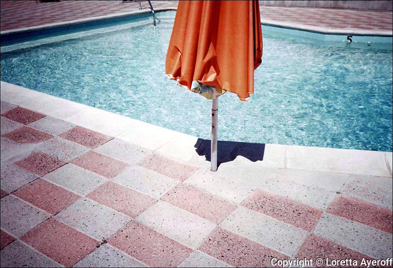 """""""Orange Umbrella"""" and two other images from this series, plus a pool image from  """"California Ruins"""" are included in Getty, 2011-2012 initiative """"Pacific Standard Time: Art in Los Angeles, 1945-1980"""" for the Palm Springs Art Museum's """"Pacific Standard Time"""" exhibition """"The Swimming Pool in Southern California Photography, 1945-1982"""" opening January, 2012. http://www.pacificstandardtime.org. """"The Motel Series"""" grew out of a portfolio on """"California Ruins"""" that I ibrought to California Magazine, published in the Nov. 1982 issue. Once the magazine took over the direction of the """"Ruins"""" Series, I began shooting a new group of images where I could have complete control again. """"The Motel Series"""" was shot on Kodachrome 64 film, with my Olympus XA Camera, in Desert Hot Springs, CA. Later, these motels became chic """"spa retreats"""" converted during the 1990's. A selection  of prints, from """"The Motel Series"""" was gifted to the Palm Springs Art Museum, for their permanent collection, in 2002."""