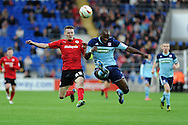 Cardiff city's Joe Mason (20) battles for the ball with Boro's Andre Bikey (r). NPower Championship, Cardiff city v Middlesbrough at the Cardiff city stadium in Cardiff in South Wales on Saturday 17th November 2012.  pic by Andrew Orchard, Andrew Orchard sports photography,