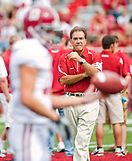 Alabama head coach Nick Saban watches members of his team warm up before the start of an NCAA college football game against Arkansas on Saturday, Sept. 25, 2010, in Fayetteville, Ark. Alabama defeated Arkansas 24-20.