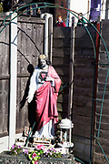 Icon of Jesus statue at Dale Farm site prior to eviction. Riot police and bailiffs were present on 20th October 2011, as the site was cleared of the last protesters chained to barricades. Dale Farm is part of a Romany Gypsy and Irish Traveller site in Crays Hill, Essex, UK<br /> <br /> Dale Farm housed over 1,000 people, the largest Traveller concentration in the UK. The whole of the site is owned by residents and is located within the Green Belt. It is in two parts: in one, residents constructed buildings with planning permission to do so; in the other, residents were refused planning permission due to the green belt policy, and built on the site anyway.