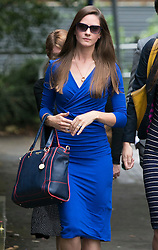"**picture sows a mans wedding ring worn around neck on necklace** © Licensed to London News Pictures. 14_07_2015. Solihull, West Midlands, UK. Pictured, BRYHER DUNSBY, widow of Cpl James Dunsby (blue dress, sunglasses). The inquest into the deaths of three army reservists taking place at Solihull Council House. Edward Maher, Craig Roberts and James Dunsby died after collapsing during an SAS training exercise on the Brecon Beacons in July 2013. The soldiers, from Hampshire, North Wales and Wiltshire, all suffered heatstroke during the 16-mile ""test week"" march. Photo credit : Dave Warren/LNP"