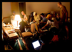 2nd Sept, 2005. The 'press' room at the Hyatt Hotel in downtown hell. New Orleans, Louisiana. Journalists and photographers turn out their stories in cramped, hot, dingy, stinking conditions.