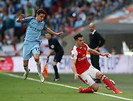 Arsenal's Granit Xhaka tussles with Manchester City's Jesus Navas during the FA Cup Semi Final match at Wembley Stadium, London. Picture date: April 23rd, 2017. Pic credit should read: David Klein/Sportimage