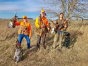 Photo credit: Bob St. Pierre<br /> <br /> Julia Schrenkler (Left,) Matt Kucharski, and Emy Marier on a Minnesota pheasant hunt.