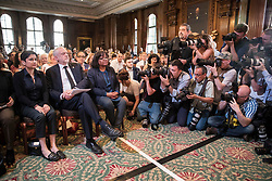 © Licensed to London News Pictures. 26/05/2017. London, UK. Labour party leader Jeremy Corbyn waits to re-start his election campaign with a speech in Westminster seated with  Labour Party shadow cabinet members Shami Chakrabarti (L) and Diane Abbott . All election campaigning was stopped as a mark of respect for the victims of Monday's terror attack in Manchester in which 22 people died. Photo credit: Peter Macdiarmid/LNP