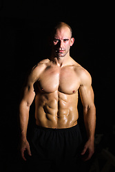 shirtless muscular man with great abs