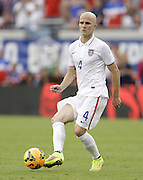 JACKSONVILLE, FL - JUNE 07:  Michael Bradley #4 of the United States passes during the international friendly match against Nigeria at EverBank Field on June 7, 2014 in Jacksonville, Florida.  (Photo by Mike Zarrilli/Getty Images)