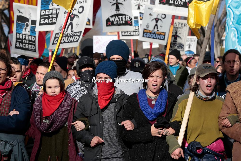 Opponents of the Dakota Access oil pipeline march on November 14, 2016. Bismarck, North Dakota, United States.