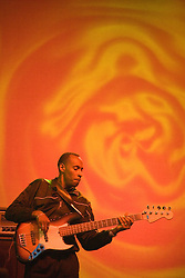Bass guitarist in band 'Culture' playing on stage at the WOMAD (World of Music; Arts and Dance) Festival in reading; 2005,