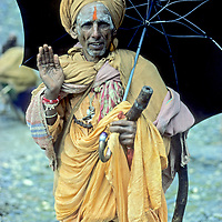 A Hindu ascetic poses during 5-day Himalayan pilgrimage to Amarnath Cave, a reputed home of Shiva in Kashmir, India.