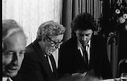 Bob Geldof Receives F.A.O.Medal..1986..16.10.1986..10.16.1986..16th October 1986..The highlight of Gorta's 21st anniversary World Food Day was the presentation of an F.A.O.(Food and Agriculture Organisation of the United Nations) to Bob Geldof. The medal was presented by An Taoiseach,Dr Garret Fitzgerald. The medal was in recognition of Bob's efforts and contribution towards famine relief in the Third World. The ceremony took place in The Berkeley Court Hotel in Dublin...At the luncheon after the awards ceremony, Bob is photographed having a quiet word with An Taoiseach, Dr Garret Fitzgerald.