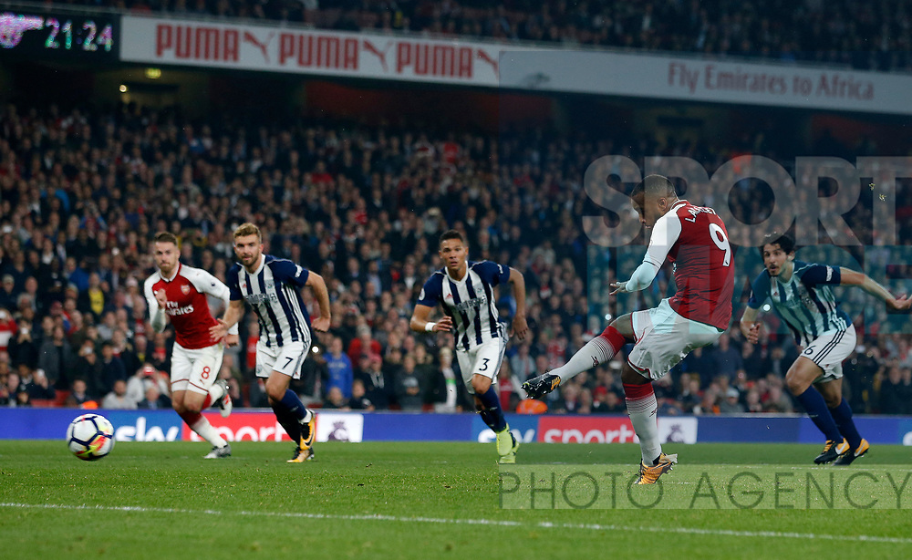 Arsenal's Alexandre Lacazette scoring his sides second goal during the premier league match at the Emirates Stadium, London. Picture date 25th September 2017. Picture credit should read: David Klein/Sportimage