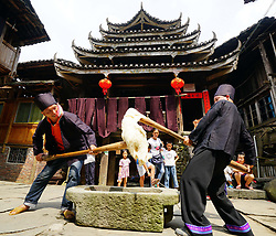 September 2, 2017 - Longsheng, Guangxi Zhuang, China - Two men compete in a labor game during the Singing Festival in Baozeng Village for the ethnic Dong group, Lejiang Town of Multinational Autonomous County of Longsheng in south China's Guangxi Zhuang. People tend to believe that the Dong ethnic group keeps its civilization passing on by singing the stories from generation to generation due to lack of written language. The festival featuring music play and daily labor competition is also an occasion to express their wish for a good harvest. (Credit Image: © Huang Yongdan/Xinhua via ZUMA Wire)
