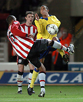 Photo: Richard Lane.<br />Southampton v Arsenal. Barclaycard Premiership.<br />29/12/2003.<br />Gael Clichy puts Fitz Hall under pressure.